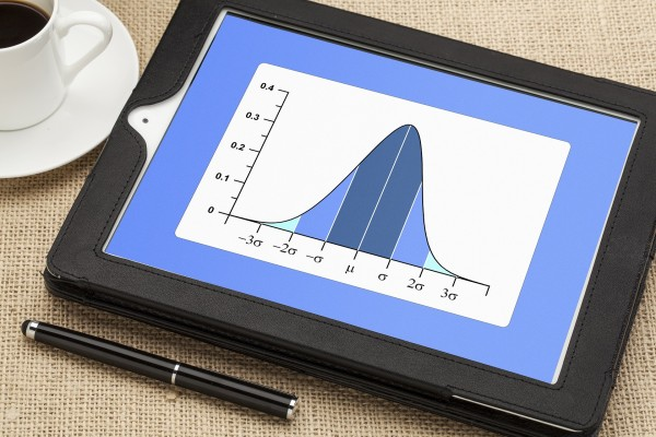 Gaussian, bell or normal distribution curve on digital tablet co