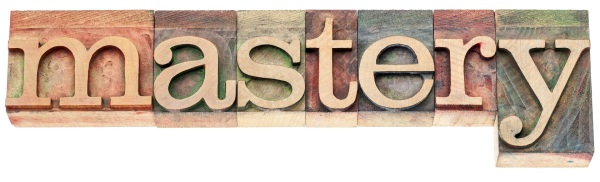 mastery  - isolated word in vintage letterpress wood type printi